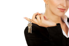 Smile businesswoman real estate agent giving keys Royalty Free Stock Images