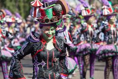 Smile in Carnival. Badajoz, Spain - March 2, 2019: Performers with costumes inspired in fantasy take part in the Carnival parade of comparsas at Badajoz City, on royalty free stock image