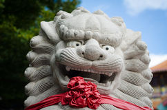 Smile chinese lion statue. In temple Stock Image