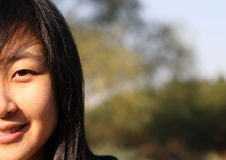 Smile of Chinese young woman. Smile of Chinse young woman in autumn times Royalty Free Stock Photo