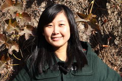 Smile of Chinese young woman. Smile of Chinse young woman in autumn times Stock Photography