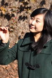 Smile of Chinese young woman of shopping. Smile of Chinse young woman in autumn times Stock Image