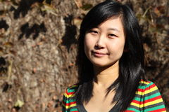 Smile of Chinese young woman of shopping. Smile of Chinse young woman in autumn times Royalty Free Stock Photos