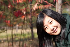 Smile of Chinese young woman of shopping. Smile of Chinse young woman in autumn times Stock Photos