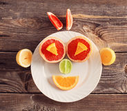 Smile citrus fruit on  plate Stock Photos