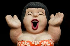 Smile clay doll girl in bikini ware black Stock Photos