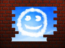 Smile cloud in hole in brick wall Royalty Free Stock Images
