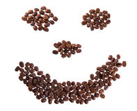 Smile with coffee beans. Roasted coffee beans placed in shape of smile on a white background Royalty Free Stock Images