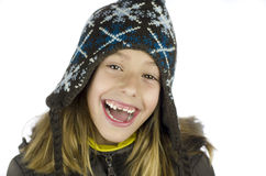 A smile from the cold. Portrait of a girl smiling with her winter earmuffs Stock Image