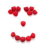 Smile composed of raspberries Stock Images