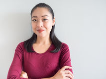 Smile and confidence woman. Smile and confidence Asian woman standing and look at camera royalty free stock image