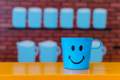 Smile cup. Happy smile cup wall background Stock Images