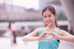 Smile cute asian girl teen love heart hand sign stock images