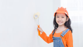 Smile cute asian little girl holding paint roller with copy spac Royalty Free Stock Photos