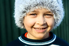 Smile of cute boy in winter season Royalty Free Stock Photography