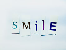 Smile - Cutout Words Collage Of Mixed Magazine Letters with White Background. Caption composed with letters torn from magazines with White Background Royalty Free Stock Images