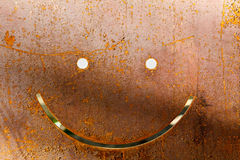 Smile on dark worn rusty metal abstract texture Royalty Free Stock Photos