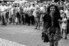 The smile of democracy. A woman walking and smiling at a demonstration in defense of Brazilian democracy. Demonstration against the habeas corpus of former royalty free stock photo