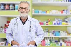 Smile doctor on medicine shelf background. royalty free stock photo