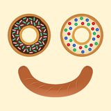 Smile doughnut and sausage Stock Image
