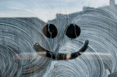 Smile drawn on fresh white painting on a glass window. Of a shop Stock Photos