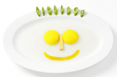 Smile Eggs with vegetable hair Stock Photo