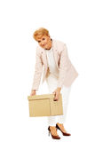 Smile elderly business woman holding cardboard box Stock Photo