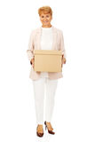 Smile elderly business woman holding cardboard box Stock Image