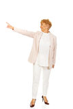 Smile elderly business woman pointing for copyspace or something.  Royalty Free Stock Images