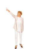 Smile elderly business woman pointing for copyspace or something.  Stock Photography
