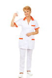 Smile elderly female doctor or nurse holds blister of pills Stock Photo