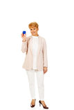 Smile elderly woman holding blue key pendant Stock Photos