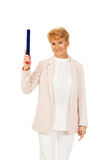 Smile elderly woman pointing up with hege pen Stock Images