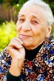 Smile of elegant content senior woman Royalty Free Stock Image