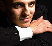 Smile of elegant handsome man with sensual eyes Stock Photo