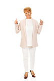 Smile elegant senior woman showing thumb up Stock Image