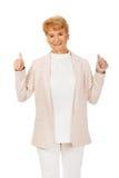 Smile elegant senior woman showing thumb up Royalty Free Stock Photo