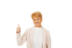 Smile elegant senior woman showing thumb up Stock Photography