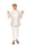 Smile elegant senior woman showing thumb up Stock Photos