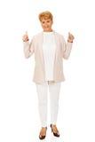 Smile elegant senior woman showing thumb up.  Stock Photos