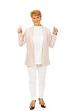 Smile elegant senior woman showing thumb up.  Stock Photo