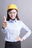Smile engineer woman. Thumb up isolated on gray background. asian stock image