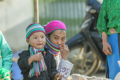 Smile of Ethnic minority mother and son. In Dong Van market, Ha Giang province, Vietnam. Ha Giang is one of the six poorest provinces of Vietnam. Ha Giang is a Royalty Free Stock Photos