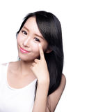 Smile eye care woman. Beautiful Woman smile pointing her eye with health long straight hair, asian beauty model royalty free stock image