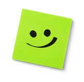 Smile face on adhesive note Royalty Free Stock Photography