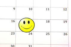 Smile face on calendar Stock Photos