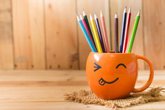 Smile face cup with color pencil Royalty Free Stock Images