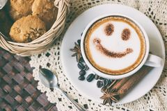 Smile face drawing on latte art coffee. Vintage style stock image