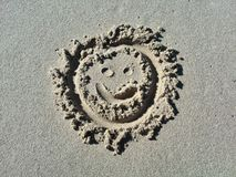 Smile face emoticon in the sand Royalty Free Stock Photos