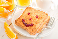 Smile face with jam on toast Stock Image